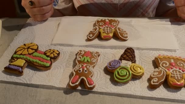 Woman is Sitting in Front of Decorated Cookies Christmas Biscuits Decorated with Colorful Mastique on a Table in Front of Woman Chocolate Buttons
