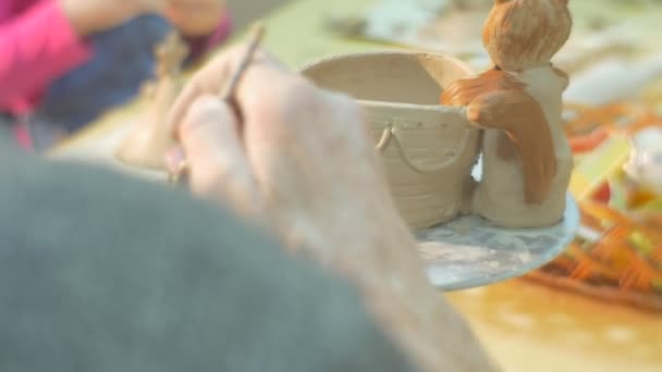 Man Male Hands Close Up Are Painting a Clay Pot Cat Figurine Glazing Pot by Brush Painting Attentively at the Table Kids Little Girl in Pink Blouse