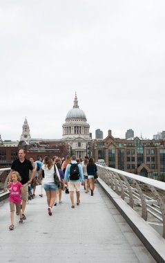 Tourists walk the Millennium Bridge, London.