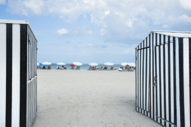 South Beach framed by black and white striped shed in Miami.