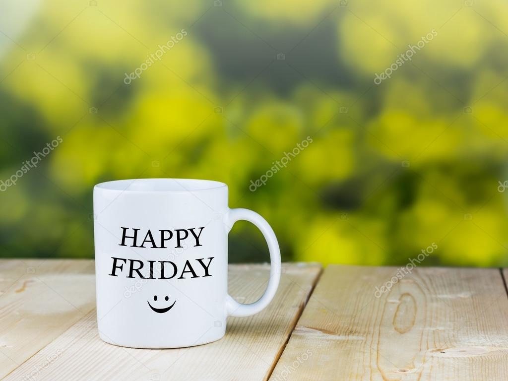 Happy Friday Smiley Face With Blurred Green Background Stock Photo
