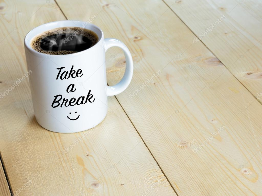 take a break with smiley face on mug or coffee cup on wood