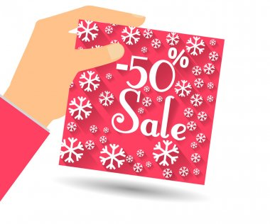 Winter sale. Discount 50 percent. Hand holds percent discount on the price. Gift card with a winter pattern with snowflakes in a flat style.
