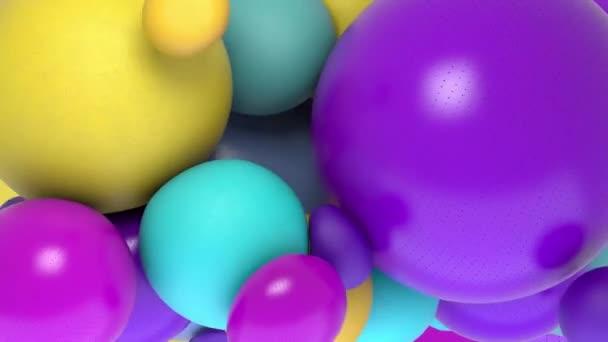 A mozgásban lévő színes golyók és körök háttere.