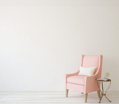 pink armchair near white wall