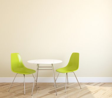 Table and two green chairs