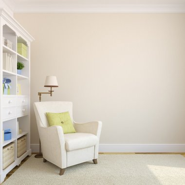 Bookcase and armchair near beige empty wall