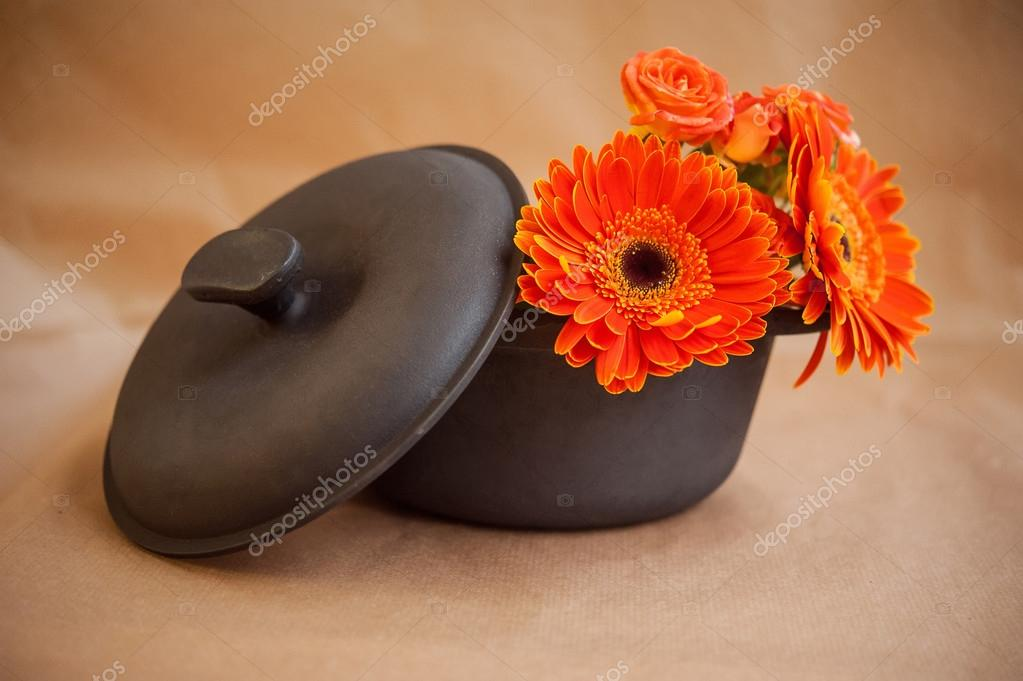 cast iron pot with flowers
