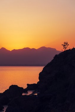 Sunrise over the mountains and the sea