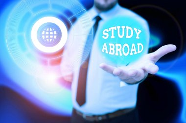 Text caption presenting Study Abroad. Business approach Pursuing educational opportunities in a foreign country Gentelman Uniform Standing Holding New Futuristic Technologies.