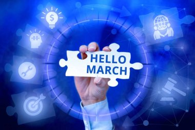 Hand writing sign Hello March. Word for a greeting expression used when welcoming the month of March Hand Holding Jigsaw Puzzle Piece Unlocking New Futuristic Technologies.