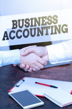 Text showing inspiration Business Accounting. Word Written on interpreting and presenting of financial information Two Professional Well-Dressed Corporate Businessmen Handshake Indoors
