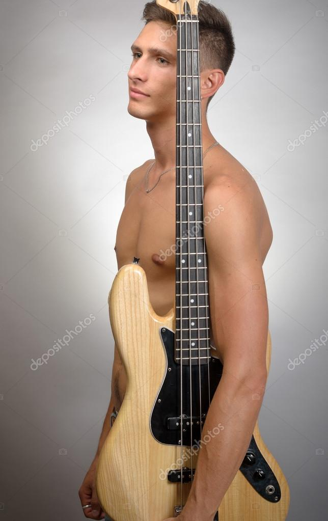 nude-naked-playing-guitar-with-big