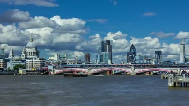 Time lapse of Blackfriars Bridge on the Thames with St Pauls Cathedral behind and the City London Skyline in the background.