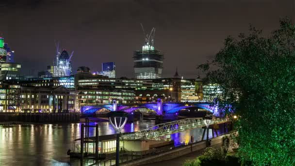Motion time lapse of Southwark Bridge and City of London at night.