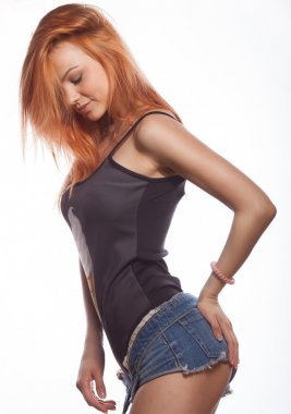 Sexy red hair woman body in jean shorts. The model is back. Great ass. On a white background.