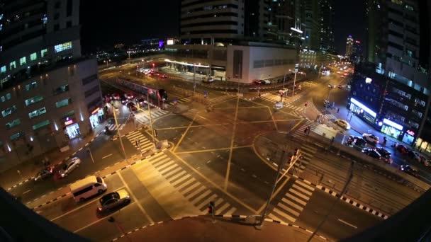tram passing in traffic Dubai at night