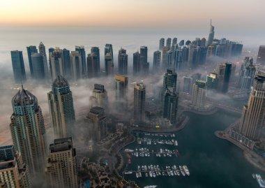 view foggy weather Dubai Marina at sunrise