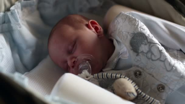 newborn baby sleeping on the bed
