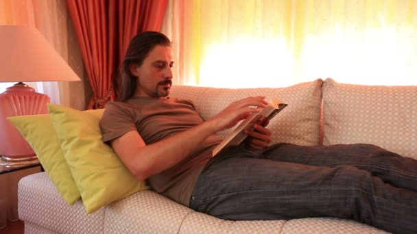 man reading book and turning page 1