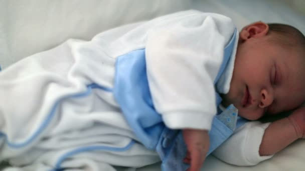 newborn baby sleeping on the bed 3