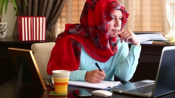 Muslim Woman Working in Office