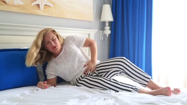 Blonde woman having abdominal pain 2