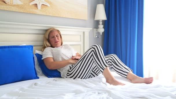 Blonde woman having abdominal pain