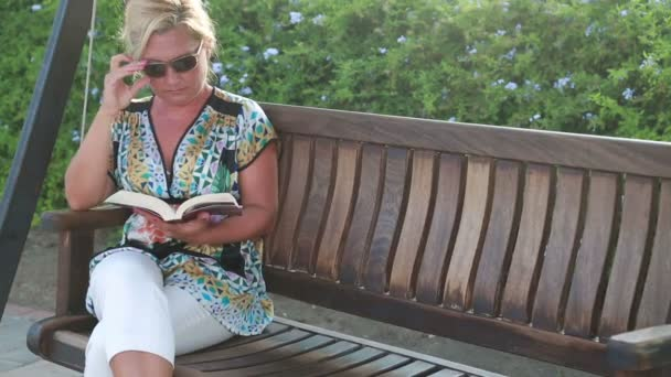 Woman relaxing in the park and reading