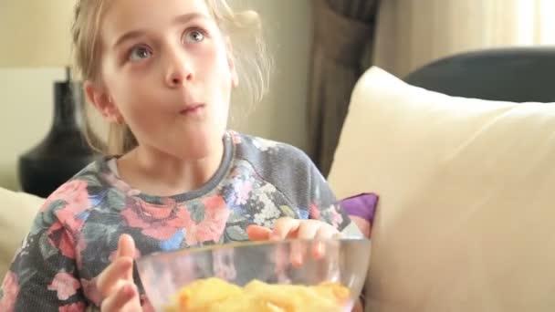 Little girl eating potato chip