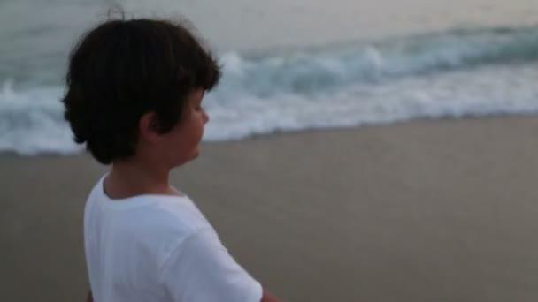 Child walking on beach