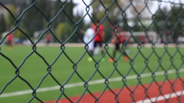 Soccer game behind the fence