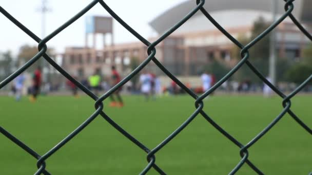 Soccer game behind the fence 3