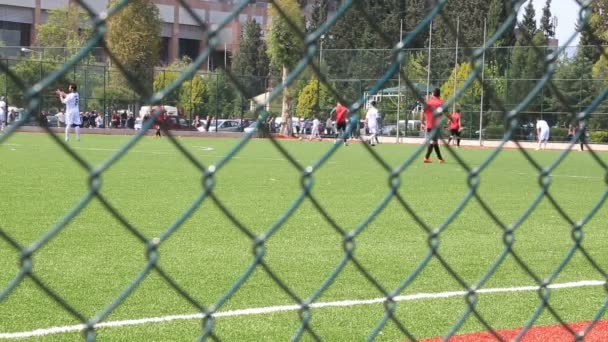 Football match  behind the fence