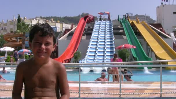 Child in aqua park smiling to a camera