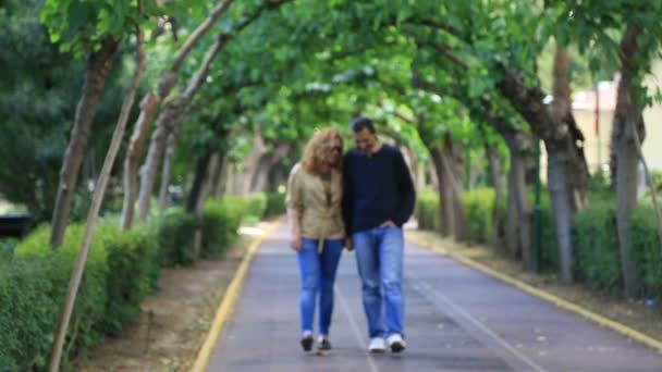 Happy couple walking 2