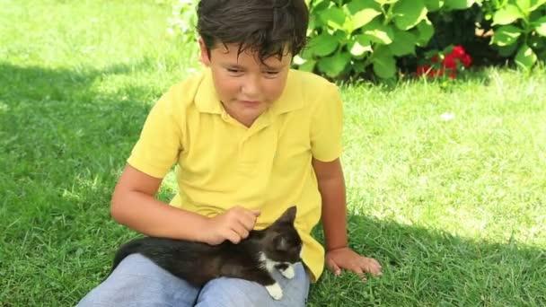Happy little boy loves his kitty