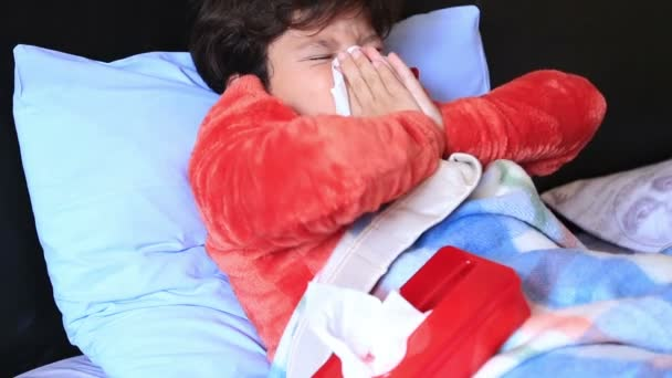 Sick child in bed sneezing