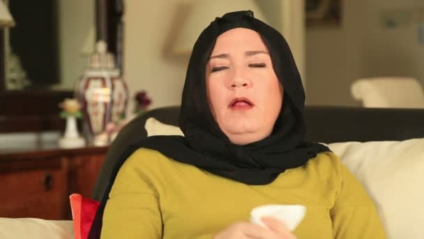 Sick muslim woman coughing
