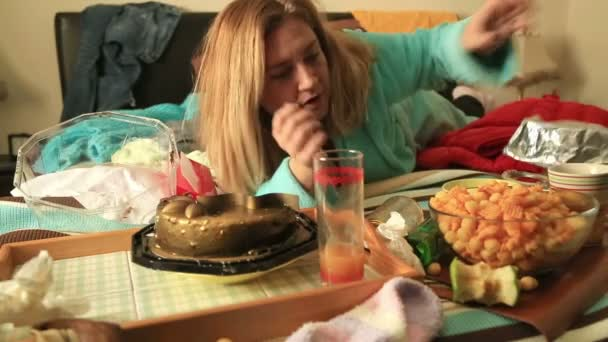 Fat woman eating a cake Stock Video videodream 98673020