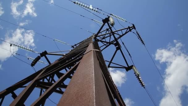 High voltage power line. High voltage tower. High voltage power pylons against blue sky and sun rays- Stock Video