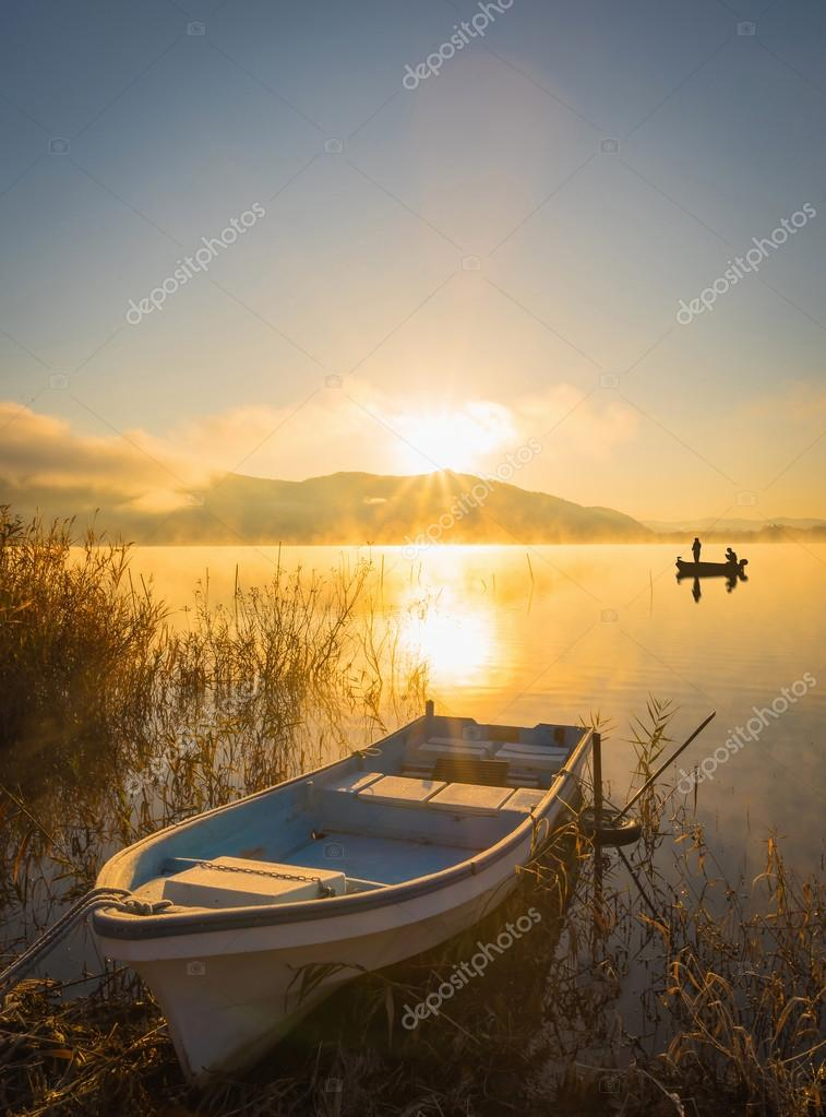 Boats on the lake Kawaguchiko, sunrise,People fishing on a boat,