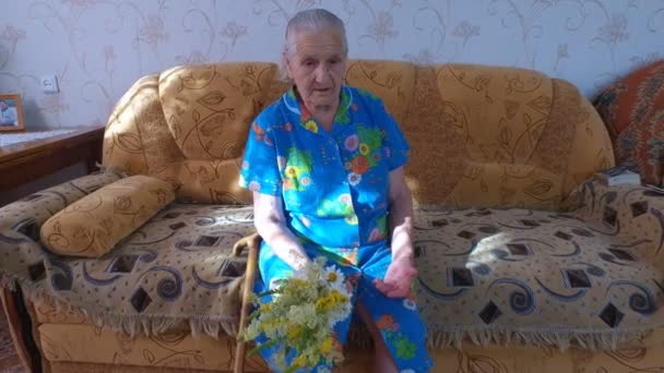 Old Woman Tells The Story Of Life Woman Sitting On A Couch In His