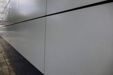 Metal facade tiles. Background. The modern facade. Gres.
