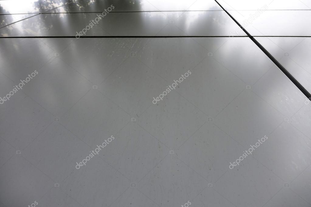 Piastrelle della facciata del metallo. priorità bassa. la facciata