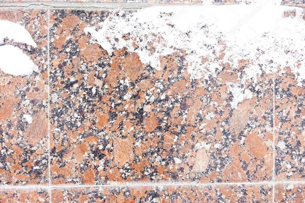 Winter background stone granite slabs covered with snow