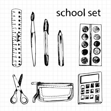 Set of different school items: ruler, scissors, pen, pencil, cal