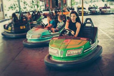 Young woman having fun in electric bumper car