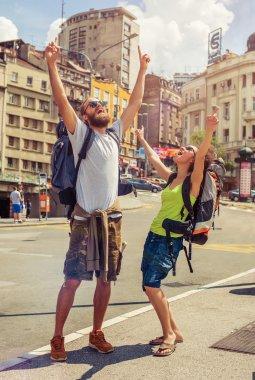 Happy couple of tourists enjoying their trip