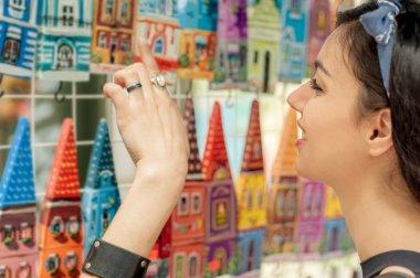 Beautiful woman buying souvenirs
